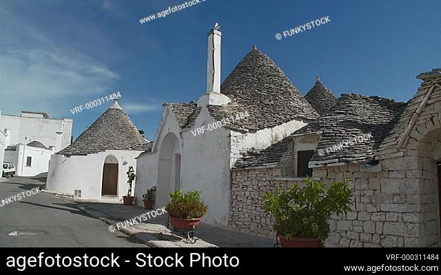 Alberobello, Apulia, Italy, 2018 : conical beehive shaped roofs of the stone built historical trullo traditional of Alberobello, static shot