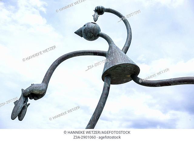 Sculpture of a puppet eating herring at the beach of Scheveningen, The Hague, The Netherlands, Europe