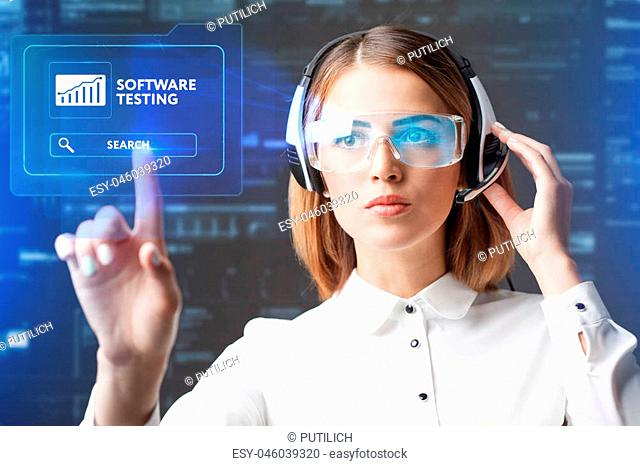 Young businesswoman working in virtual glasses, select the icon software testing on the virtual display