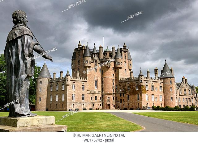 Front lawn of Glamis Castle childhood home of Queen Mother with lead statue of King James I of England and King James VI of Scotland