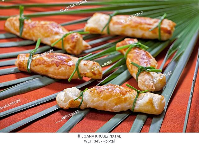 Aperitif with puff candy, stuffed with cream cheese and Swiss mountain cheese