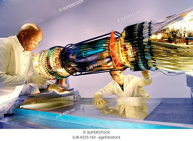Scientists Work on the Silicon Strip Vertex Detector