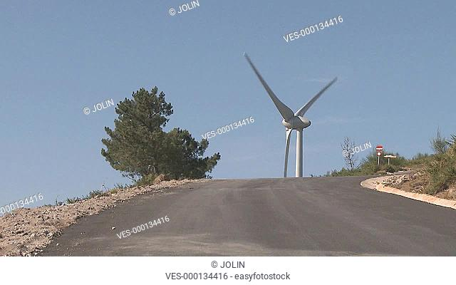 Wind power turbine at the top of the road