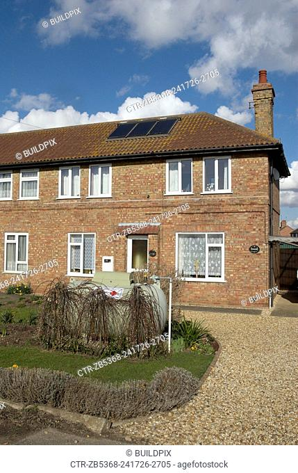 Semi-detached home with solar panels and oil heating, Norfolk, UK