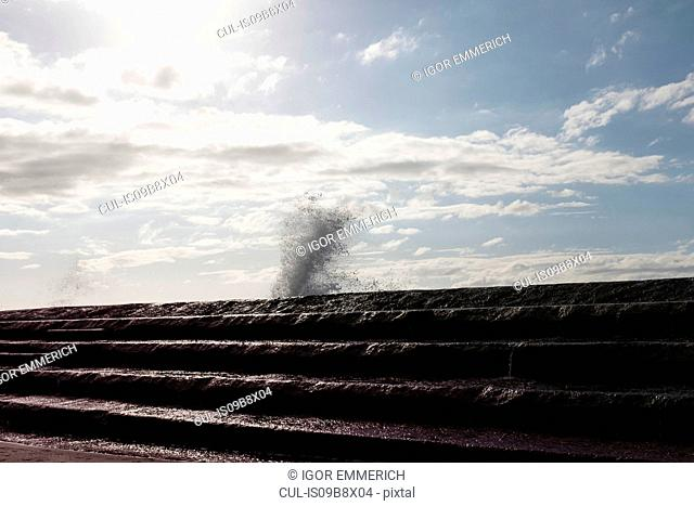 Waves crashing against sea wall, Santa Cruz de Tenerife, Canary Islands, Spain, Europe