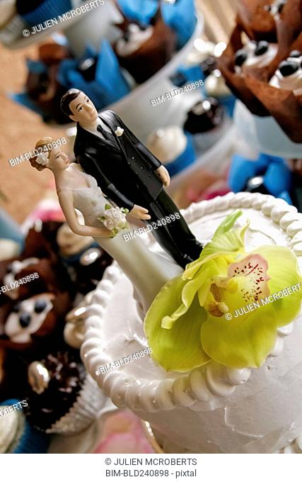 Bride and groom toppers on wedding cake