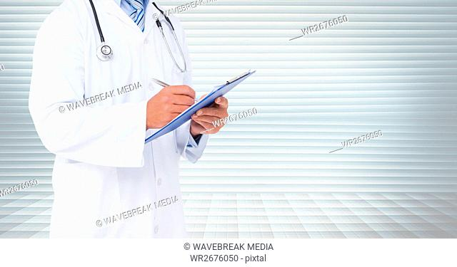 Doctor writing on clipboard against window blinds