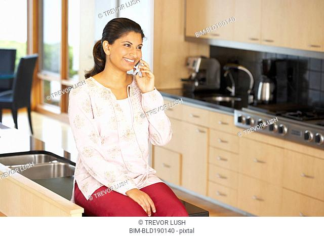Indian woman talking on cell phone