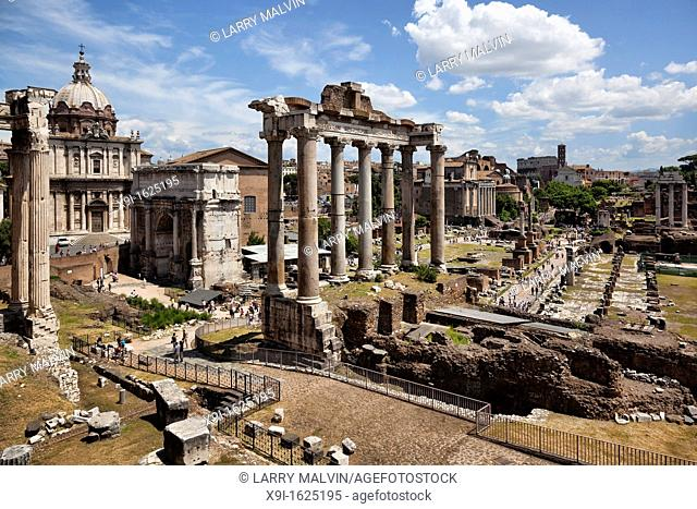 Panoramic view of the Roman Forum with the Colosseum in the distance in Rome, Italy
