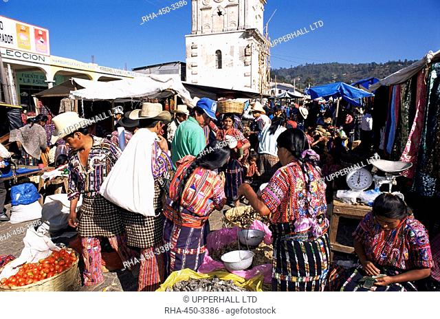 Women in traditional dress in busy Tuesday market, Solola, Guatemala, Central America