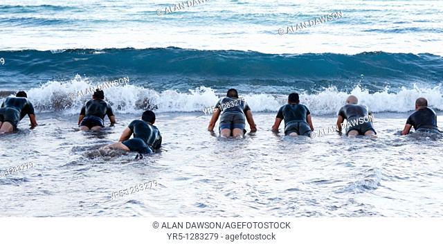 Spanish soldiers doing press ups in sea  Playa de Las Canteras, Las Palmas, Gran Canaria, Canary Islands, Spain