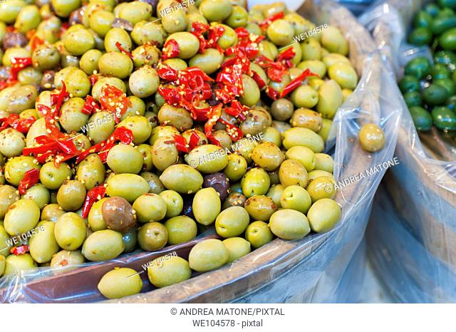 Green olives with spicy red peppers