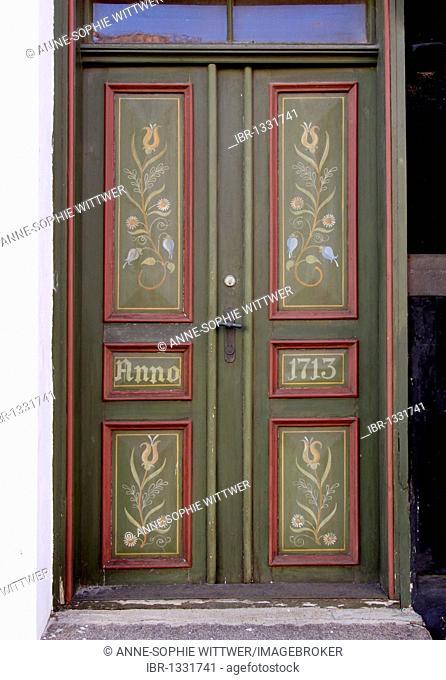 Colourfully painted old door from 1713 in Bogense, Funen, Fyn, Denmark, Europe