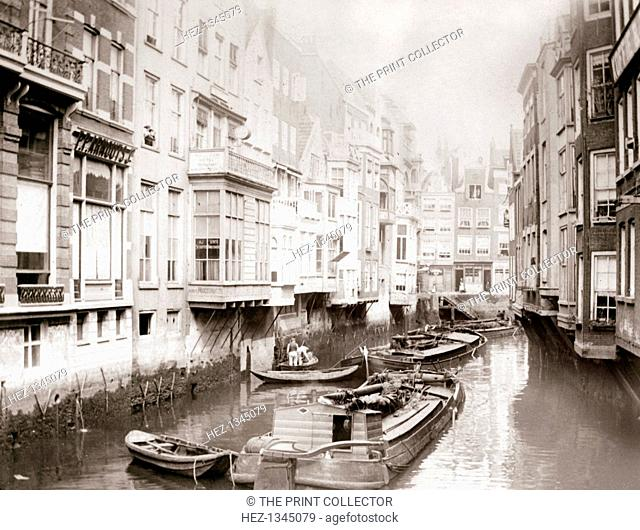 Boats on the canal, Amsterdam, 1898. Illustration from a book of photographs taken in Holland and Belgium by James Batkin, (1898)