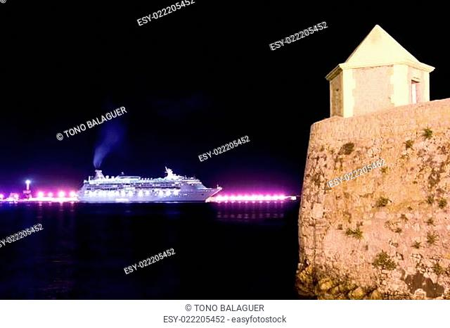 Ibiza night town cruise ship lights and tower