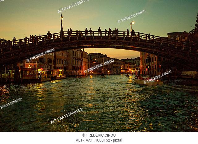 Tourists visit the Accademia Bridge (Ponte dell'Academia) on the Grand Canal, Venice, Italy