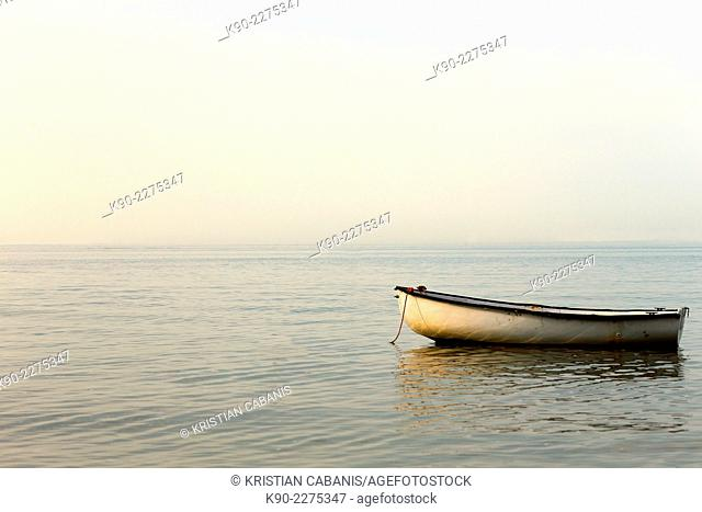 Rowboat laying in the North Sea off the coast of Amrum, North Frisian islands, Schleswig-Holstein, Germany, Europe