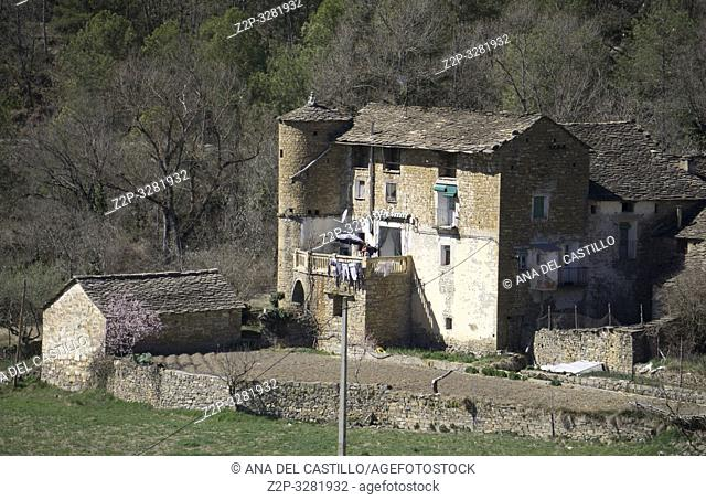 Landscape in Sobrarbe county Huesca Aragon Spain. Medieval farm with round tower. Arro village