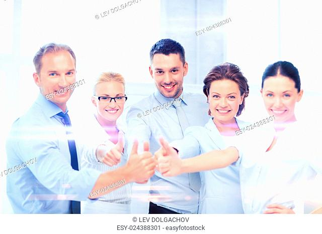 business and office concept - business team showing thumbs up in office