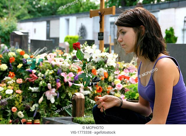 Young woman mourns on a fresh grave - 01/01/2009