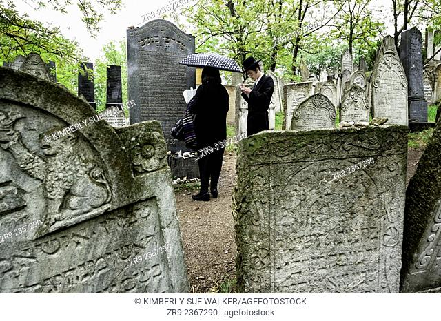 Jewish man and his mother pay respects at the Jewish Cemetery, South Moravia, Mikulov, Czech Republic, Europe