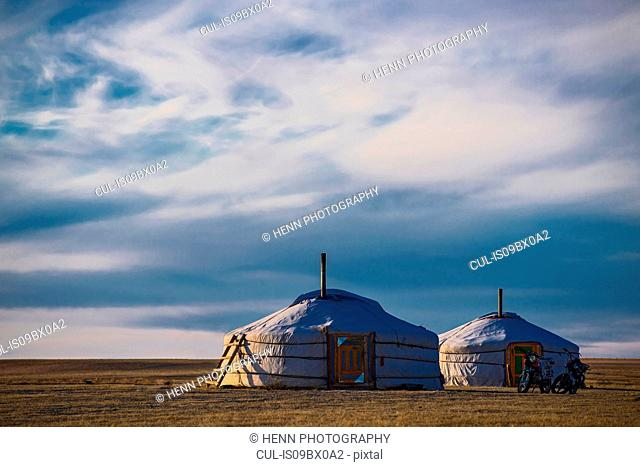 Motorcycles parked by ger or yurt camps, Gobi desert, Mongolia