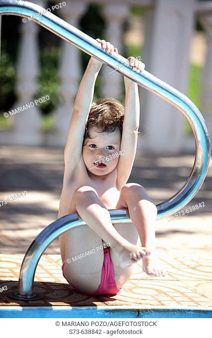 4 years old girl in swimming-pool