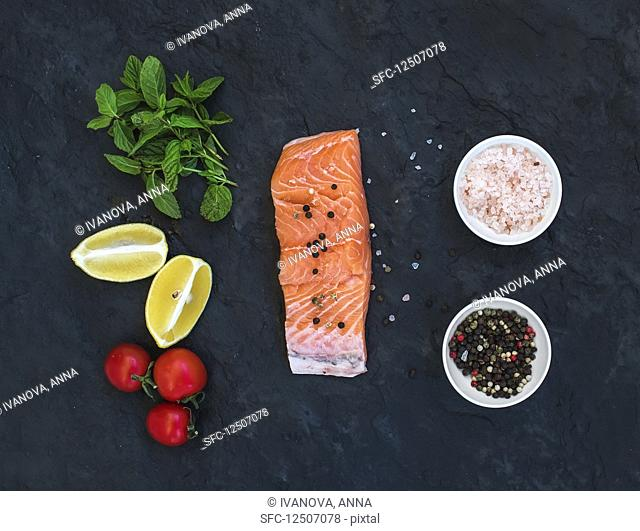 Raw salmon filet, lemon, cherry tomatoes, fresh mint and spices