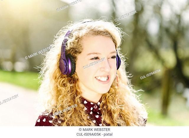 Portrait of teenage girl listening to headphones