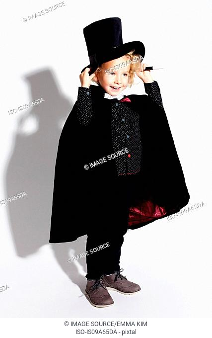 Boy wearing magician costume