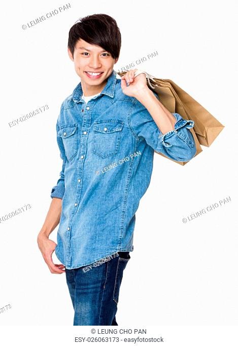 Young man holding with shopping bag