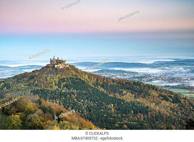 Hohenzollern castle in autumnal scenery at dawn. Hechingen, Baden-Württemberg, Germany