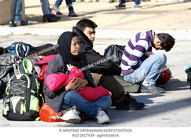 23 February 2016, Piraeus Greece. Migrants and refugees wait in a queue to receive food distributed by Red Cross after their arrival from the eastern Greek...