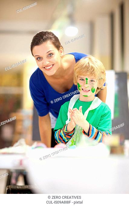 Young woman and boy in art class