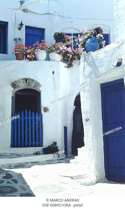 greece white and blue architecture color facade with vases and flowers