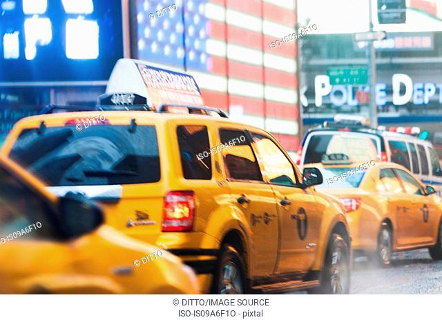 Yellow cabs and american flag, New York City, USA