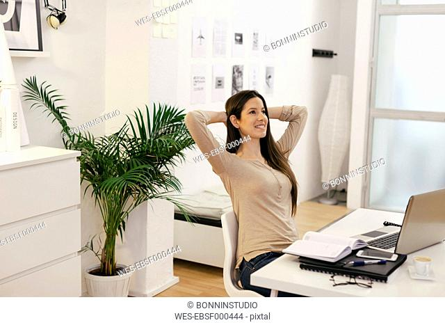Young female entrepreneur having a rest at home office