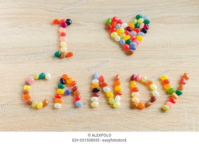 I love candy from jelly beans on wooden background