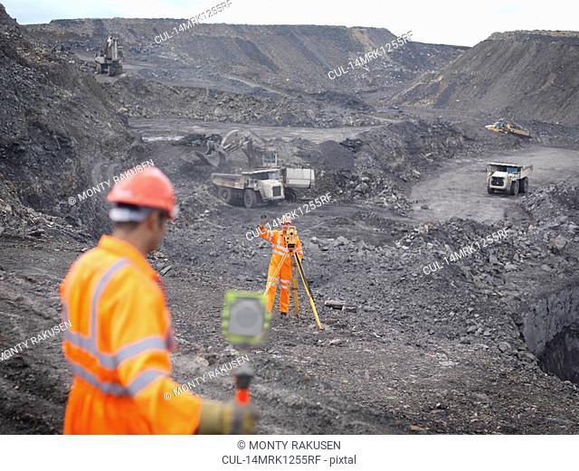 Coal Miners Surveying Mine