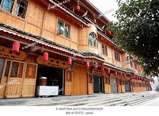 Traditional wooden house with Chinese shops in the Miao village, San Ke Shu, Guizhou Province, China