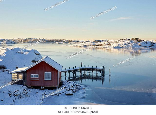 Lake and boat house in winter scenery