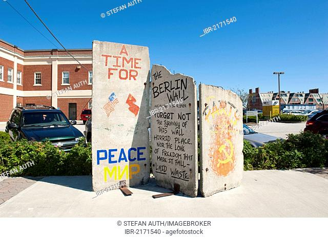 Three panels of the Berlin Wall, graffiti The Berlin Wall, on display at Long Wharf, Portland, Maine, New England, USA, North America, America
