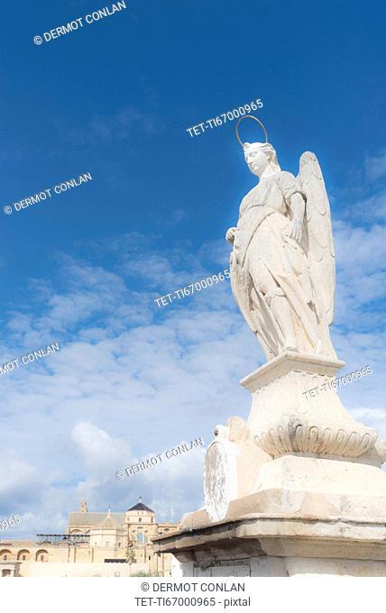 Spain, Andalusia,Cordoba, Statue of San Rafael against clouds