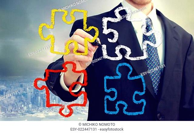 Businessman with puzzle pieces