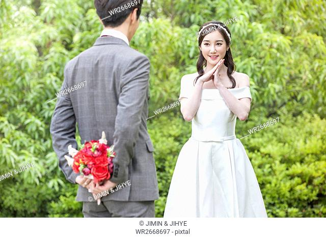 Young romantic wedding couple outdoors