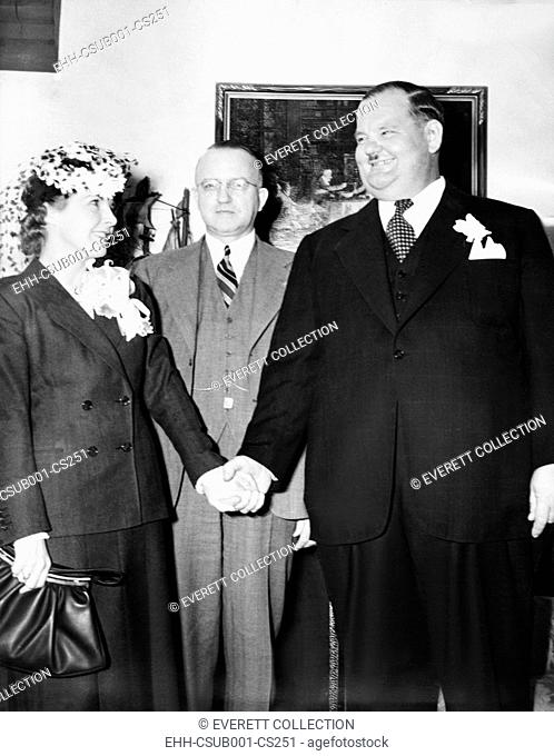 Comedian Oliver Hardy weds studio script girl, Virginia Lucille Jones, in Las Vegas, Nevada. Judge Roger Foley, (center) married them on March 8, 1940