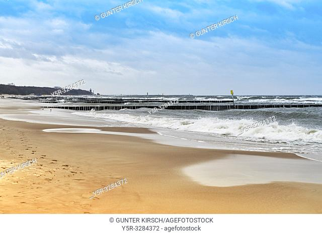 Sandy Beach with groynes on the Baltic Sea. Groynes are intended to break the shaft and to prevent the erosion of the coast