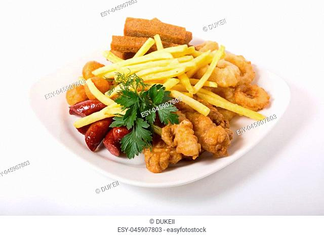 Different beer snacks, french fries, croutons and sausages