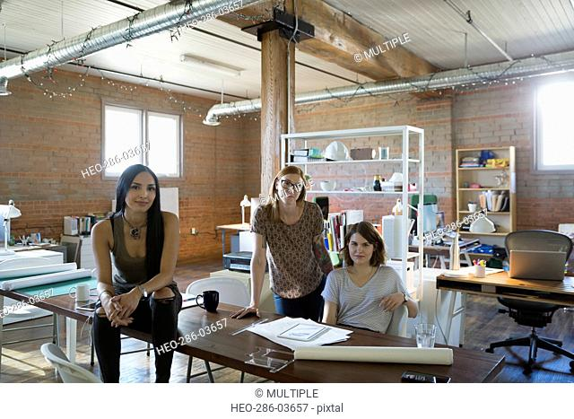 Portrait confident female designers in office