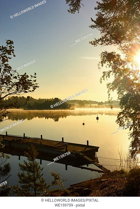 View over lake at dawn, Ljustero, Stockholm County, Sweden, Scandinavia. . Ljustero is an island in the northern part of the Stockholm archipelago
